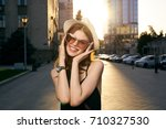 woman in a hat and sunglasses... | Shutterstock . vector #710327530