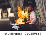 the chef prepares the foie gras ...   Shutterstock . vector #710359669
