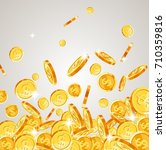 realistic gold coins falling... | Shutterstock .eps vector #710359816