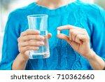 receiving vitamins. concept... | Shutterstock . vector #710362660
