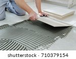 the hands of the tiler are... | Shutterstock . vector #710379154