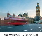 a london bus streaking over... | Shutterstock . vector #710394868
