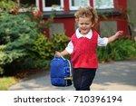 a little boy running to school...   Shutterstock . vector #710396194