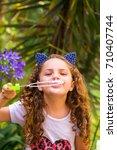 happy little curly smiling girl ... | Shutterstock . vector #710407744