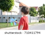 little boy playing with soap... | Shutterstock . vector #710411794