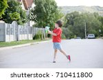 little boy playing with soap... | Shutterstock . vector #710411800