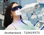 teeth whitening for woman.... | Shutterstock . vector #710419573