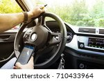man with phone in hands at the... | Shutterstock . vector #710433964