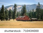 barn and view of mountains at... | Shutterstock . vector #710434000