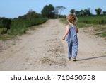 a little boy dressed in blue... | Shutterstock . vector #710450758