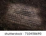 tyre track on dirt sand or mud  ... | Shutterstock . vector #710458690