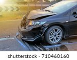 front of black car crushed... | Shutterstock . vector #710460160