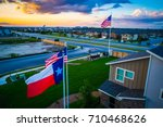 texas flag in the foreground... | Shutterstock . vector #710468626