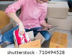 small business owner packing... | Shutterstock . vector #710494528