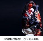 young pretty geisha in kimono... | Shutterstock . vector #710518186