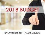 businesswoman hand touch 2018... | Shutterstock . vector #710528308