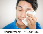 men with use white tissues to... | Shutterstock . vector #710534683