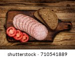 bread  salami and tomatoes on a ... | Shutterstock . vector #710541889