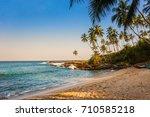 wild beach in the evening.... | Shutterstock . vector #710585218