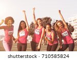 portrait of cheering women... | Shutterstock . vector #710585824