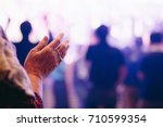 hands old woman raised up... | Shutterstock . vector #710599354