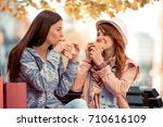 two young girls sit on a bench. ... | Shutterstock . vector #710616109
