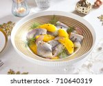 Stock photo herring salad with orange and dill for christmas 710640319