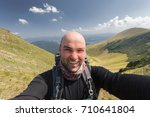 hiker taking a selfie while out ... | Shutterstock . vector #710641804