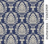 seamless damask wallpaper.... | Shutterstock .eps vector #710653909