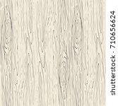 seamless wood grain pattern.... | Shutterstock .eps vector #710656624