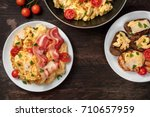 scrambled eggs in a pan  on a... | Shutterstock . vector #710657959