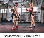 muscular man doing kettlebell...   Shutterstock . vector #710684290