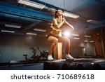 Fit Young Woman Jumping On Tir...