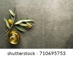olive oil and olive branch on... | Shutterstock . vector #710695753
