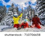 happy family enjoying winter... | Shutterstock . vector #710706658