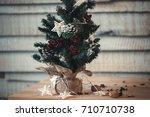 christmas fir tree on wooden... | Shutterstock . vector #710710738