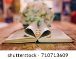 Wedding Rings On A Book