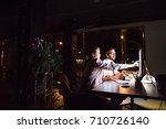 Small photo of Businesspeople in the office at night working late.