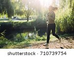 fit female jogger running in... | Shutterstock . vector #710739754