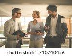 business people in office... | Shutterstock . vector #710740456