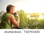 back view of a man drinking hot ... | Shutterstock . vector #710741320