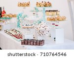 candy bar with eclairs  cakes ... | Shutterstock . vector #710764546