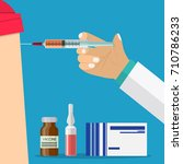 doctor hand with syringe making ... | Shutterstock .eps vector #710786233