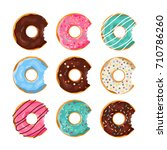 set of colorful donuts with a... | Shutterstock .eps vector #710786260