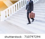 young asia businessman walking... | Shutterstock . vector #710797294