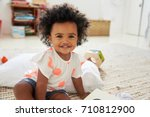 portrait of happy baby girl... | Shutterstock . vector #710812900
