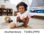 cute baby girl having fun in... | Shutterstock . vector #710812990