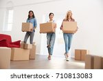 three female friends carrying... | Shutterstock . vector #710813083