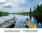 lake with canoe in the canadian ... | Shutterstock . vector #710821603