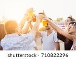 friends drinking beer and... | Shutterstock . vector #710822296